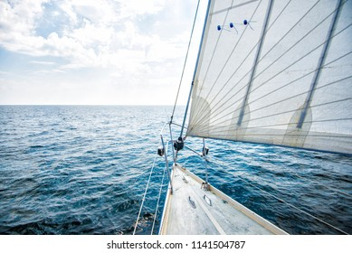 Pure morning light over he Baltic sea. A view from the sailboat's deck to the bow and sails, Estonia