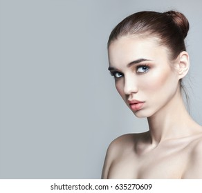 Pure perfect skin and natural makeup, skin care, natural cosmetics. Long eyelashes and big eyes. Beautiful attractive Nude woman. Natural makeup on a girl's face
