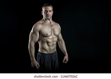 Pure perfection. Man bodybuilder posing with tense muscles on black background. Bodybuilder achieved best shape for muscles. Ready for championship. Bodybuilder perfect muscular body, copy space.