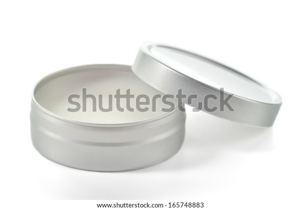 Pure shea butter in metallic tin isolated on white background. Perfect lip balm and beauty balm.