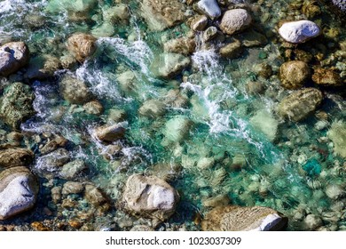 pure turquoise water in a mountain stream, a picture from above. Nature and ecology concept. Abstract background