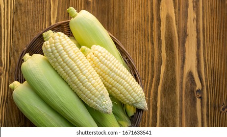 Pure white corn on a wooden table.