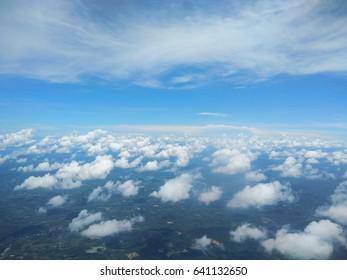 Pure white fluffy clouds like pandas Beautiful blue sky, like a painting.