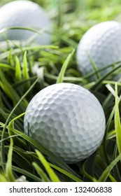 Pure White Golfball on bright green grass