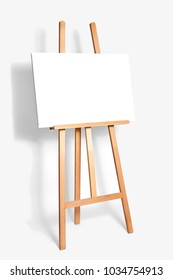 pure white synthetic canvas stretched on a wooden stretcher standing on a wooden easel for artists. Gray monophonic background. Art, creativity, hobby, job and creative occupation concept