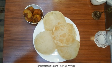 Puri and Alu dum are one of the best indian cuisine available for breakfast or dinner. Puri is also popularly called luchi in bengali language whichh is made of flour and is deep fried in white oil.