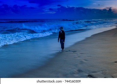 Puri beach with silhouette woman at the time of dawn