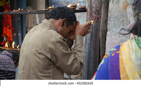 PURI, INDIA - 29 MAY, 2016: An unidentified Indian poor man praying outside Indian temple.