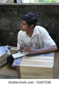 PURI, INDIA - NOV 15 - Student practises engraved calligraphy on palm leaves on Nov 15, 2009 in Puri, India