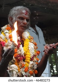PURI, INDIA - NOV 17 -  Hindu shaman priests swallow fire before they give predictions to their followers  on Nov 17, 2009  in Puri, India