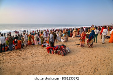 Puri, Odisha, India - January 9, 2014 - Crowding of local Indian people live their morning life on Puri Beach, Odisha.