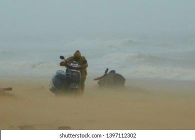 Puri, Odisha / India - May 4, 2019: A man With His Bike, Huge Damage Aftermath Of Extreme Severe Cyclonic Storm FANI Hits Puri Odisha India