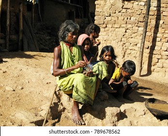 Puri, Odisha, India Nov 12, 2017 Tribal family sitting outside a house in summer