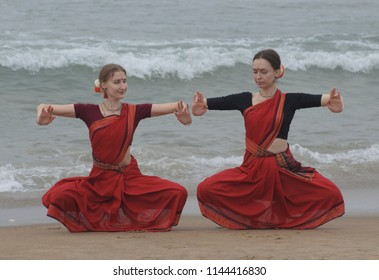 Puri, Orissa - Feb 13, 2018: Traditional dance form of Orissa called Odissi. The two Russian lady is practising Odissi on the Puri beach.