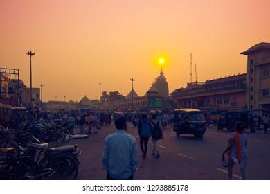 PURI, ORISSA / INDIA - JANUARY 16, 2019: Man watching the sunset over Shree Jagannath Temple