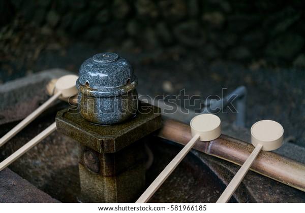 Purification fountain near the shrine's entrance. Kyoto, Japan.