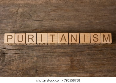 puritanism word written on wooden cubes