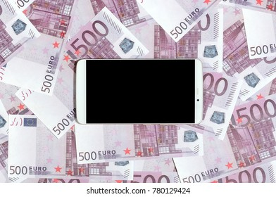 Purple 500 euro money bills and a smartphone with black screen. Copy space. The concept of online banking, money management and shopping with modern technology