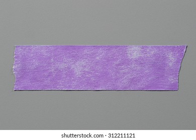 Purple Adhesive Tape on Grey Background with Real Shadow. Top View of  Masking Tape, Label or Paper Tag. Sticker Close Up with Copy Space for Text or Image