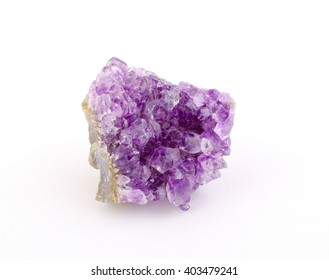Purple amethyst stone isolated on white (as rough amethyst crystals)