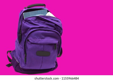 Purple backpack on pink background