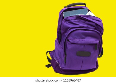 Purple backpack on yellow background