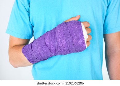 Purple bandage on the broken hand of a teen