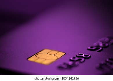 Purple bank credit or debit card with negative copy space, suitable for adding text, contactless no contact wireless payment system, smart secure card concept, macro detail close up shot
