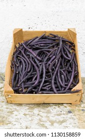 Purple beans in a wooden vegetable box