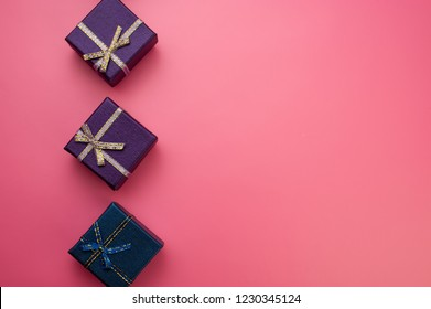 purple and blue christmas boxes on pink background. Web design. For the blog.