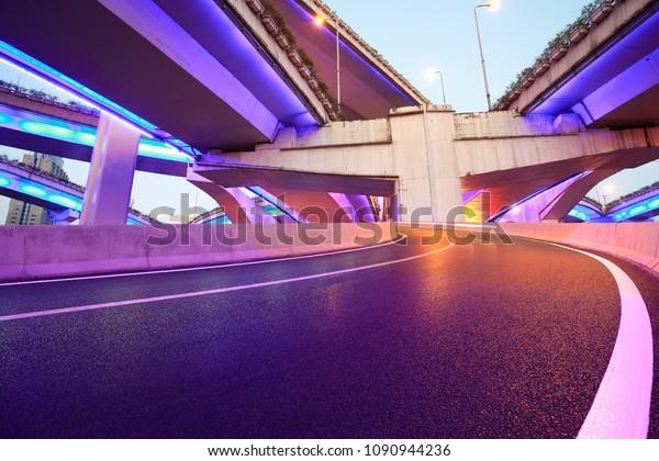 The purple blue LED landscape lamp of city overpass viaduct bridge of night scene in shanghai