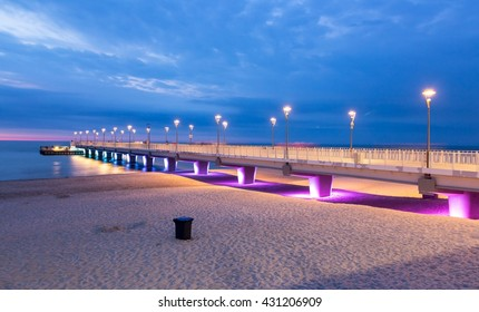Purple blue lights on the pier in the evening, Kolobrzeg, Poland