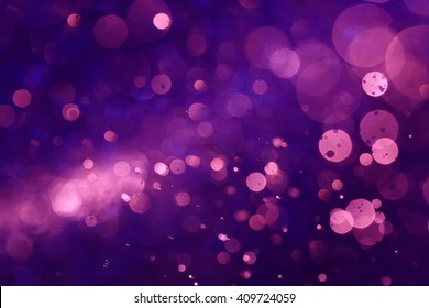 Purple bokeh abstract background caused by spray water.