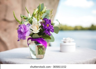 purple bouquet of flowers for a wedding ceremony