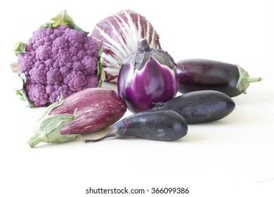 Purple broccoli and Aubergines, London, photographic still life, CatMicroStock