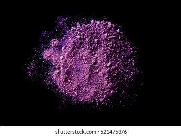 purple broken and spilled eye shadow on a black isolated background