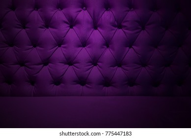 Purple burgundy velvet texture or background and soft tufted fabric furniture diamond pattern decoration with buttons.