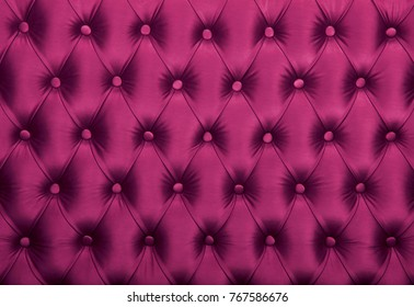 Purple capitone textile background, retro Chesterfield style checkered soft tufted fabric furniture diamond pattern decoration with buttons, close up