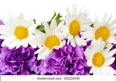 ?hamomiles and  purple carnation bouquet isolated on the white