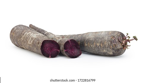 Purple carrots isolated on white background.