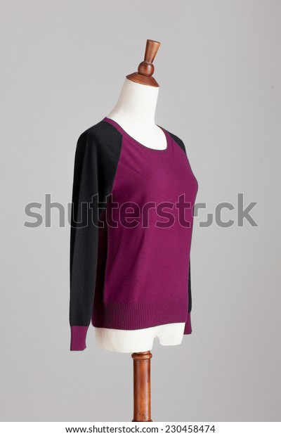 purple cashmere sweater with wood model on grey isolated
