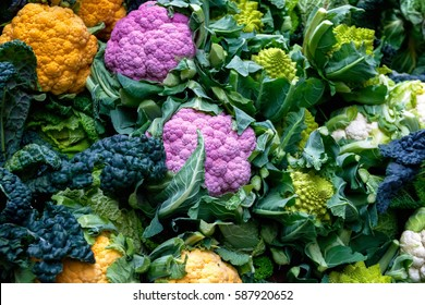 Purple cauliflower, orange cauliflower and Roman cauliflower on display at borough market in London