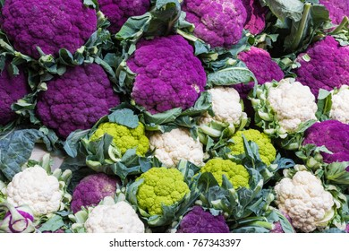 Purple cauliflowers on a farmers market stand in Sicily, Italy.