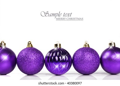 Purple christmas baubles with space for text