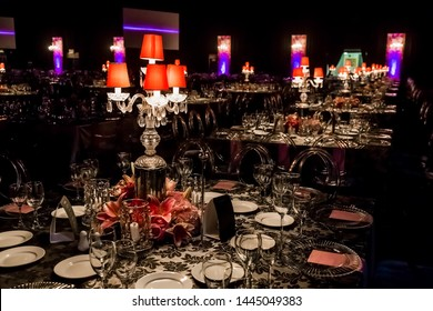 Purple Christmas Decor with candles, flowers and lamps for a large corporate party event or Gala Dinner