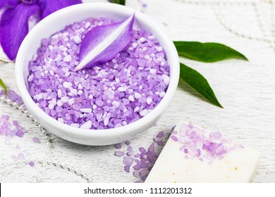 Purple Clematis Salt for Spa and Aromatherapy. Selective focus.