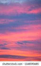 Purple clouds red late afternoon