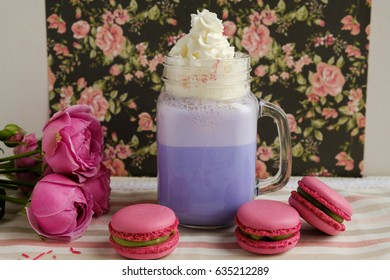 Purple Coffee In Stylized Mason Jar Cup With C And Roses Colorful Decoration On Background