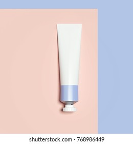 Purple cosmetic tube isolated on orange background. 3d rendering