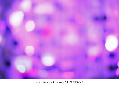 Purple curtains with blur. It looks like a holiday with serpentine, glow and brilliance.